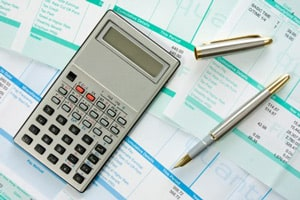 calculator, pens and labor sheets